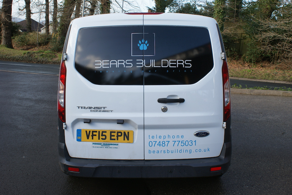 A white Ford Connect van showing Bears Building Company