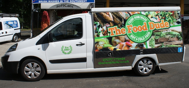 A food delivery van with full colour printed signage